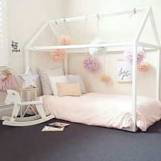 Shop our toddler floor bed, available in white or grey, with an adorable house design. Create your child's dream room today!