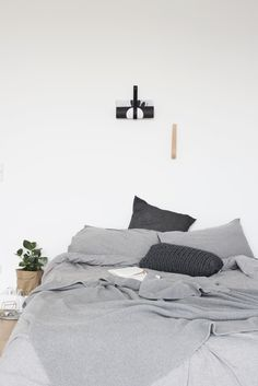 Via CocoLapineDesign.com | Minimal Grey Bedroom