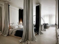Faked four-poster bed with curtains from ceiling. So pretty and dramatic for a simple room | Rick Joy via Hege in France