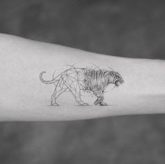 Geometric tiger tattoo by Sanghyuk Ko