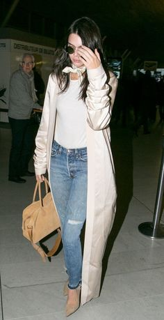 Kendall Jenner in jeans, a t-shirt, and a duster coat.
