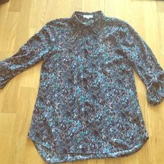 Sheer top with racer back cut out Black/purple/teal printed polyester top with small cut outs in back- great for showing off a cute bra! Like new, worn 1-2 times, perfect condition. Easy machine wash care. Looks great with black pants or skinny jeans! Tops Blouses