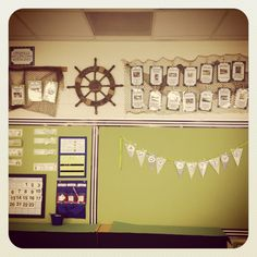 My nautical kindergarten classroom!  Using fish nets and clothes pins to hang my life skills!