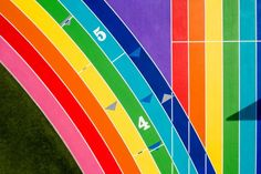 Nike paints Los Angeles running track in pride flag colours Running Art, Running Track, Flag Colors, Colours, Los Angeles City College, Running Cartoon, Cross Country Running, Drone Photography, Sports