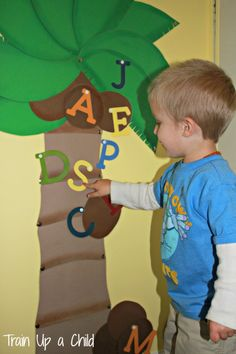 Make your own Chicka Chicka Boom Boom alphabet tree - Children will love seeing the story come to life as they learn the alphabet.