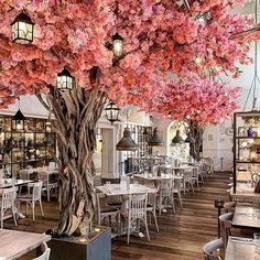 // S U N D A Y I N S P I R A T I O N // What a beautiful additiona this colorful tree is to this restaurant space! Decoration Restaurant, Restaurant Interior Design, Restaurant Furniture, Bakery Design, Cafe Design, Bold Wallpaper, Unique Restaurants, London Restaurants, Beauty Salon Interior