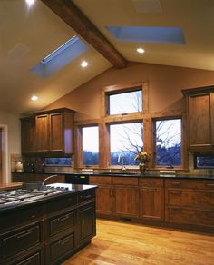 Ahhhh, dark cabinets and look at those windows. Nice.