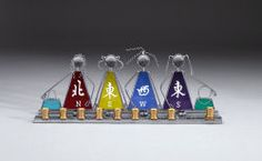 #mahjong menora - Make Hanukkah as memorable as it can be with this beautiful stained glass menorah.  Each woman has the Chinese symbol for each wind, North, South, East and West.  Holds standard #Hanukkah tapers.  Set in a sturdy metal frame.  A must have for any Mahj enthusiast.
