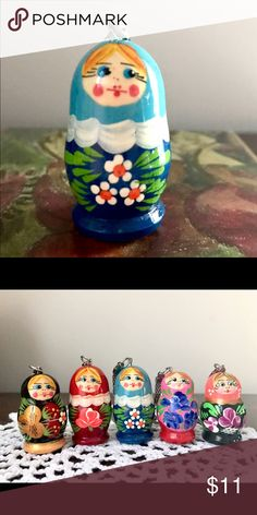 Keychain-Authentic Russian Matryoshka Nesting Doll Beautiful brand new Russian Nesting Doll made of wood, hand painted in Russia. Colors of blue and white with cute white daisies at front surrounded with green leaves. Small and lightweight. Accessories Key & Card Holders
