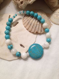 Turquoise & white shell beaded stretch bracelet. on Etsy by WSJ
