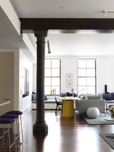 Nexus Designs, TriBeCa loft. Like the bench and west elm style rock end table