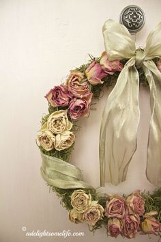 DIY Shabby Chic Christmas wreath using dried rosebuds, Spanish moss, an embroidery hoop and sheer gold ribbon -  adelightsomelife.com