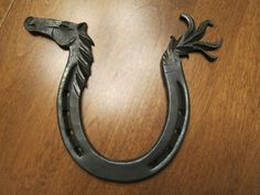 Beautiful Horseshoe Sculpture Hand Forged | eBay.  A good friend made me one of these for a 21st birthday present. thanks for pinning it...