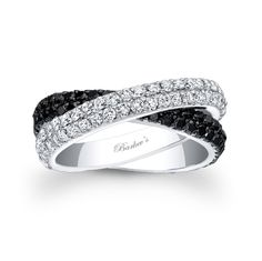 Beautiful black and white diamond wedding band, featuring two crossing double row bands of shared pring set diamonds,one band is white diamonds while the other crosses underneath and is set with black diamonds for a modern contemporary flair.