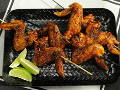 """Get this all-star, easy-to-follow Sunny's Root Beer BBQ Wings recipe from Sunny Anderson. Named """"bats outta hell"""" on Halloween show"""