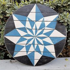 "The color combinations of blue and white in barn stars were meant to bring peace and serenity to a family and home. This Serenity 12 Point Barn Star is 22"" round, made of solid wood, hand painted in detail, and sealed for use indoors or out."