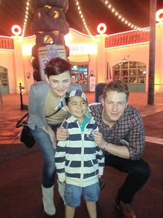 Ginnifer Goodwin and Josh Dallas with a fan at...it looks like maybe Disneyland? || Once Upon A Time - Snow White & Prince Charming