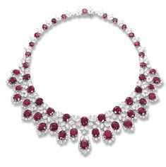 AN IMPORTANT RUBY AND DIAMOND NECKLACE, BY BULGARI   Designed as a graduated line of oval-shaped rubies and pear-shaped and marquise-cut diamond clusters supporting a ruby and diamond fringe, 38.5 cm long, in fitted black suede Bulgari case  Signed Bulgari