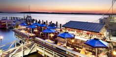 DINE at Hudson's Seafood House on the Docks in Hilton Head Island, SC. Sitting right on the dock overlooking the channel, Hudson's serves lunch and dinner daily, offering fresh seafood and other options. Hilton Head South Carolina, Carolina Beach, North Carolina, Oh The Places You'll Go, Places To Travel, Places To Visit, Time Travel, Seafood House, Seafood Restaurant