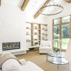 One of our favorite parts about building is bringing our clients dreams to life!  #customhome #customhomebuilder #transitional #modern #transitionalmodern #fireplace #white #brightwhite #brightwhitewednesday #homedecor #interiordesign #home #custom #wednesdaywooddecor #theigdreamhome  #light