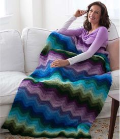 Prepare yourself for empowerment with this Spellbinding Crochet Ripple Blanket from our friends at Red Heart. Chevron crochet is very trendy right now, so wave your hooks in the air and cast this spell of a crochet pattern! Crochet Afghans, Crochet Ripple Blanket, Crochet Edgings, Crochet Shawl, Chevron Crochet Patterns, Afghan Crochet Patterns, Chevron Afghan, Rug Patterns, Knitting Patterns