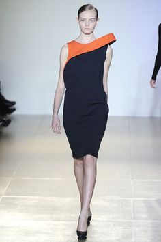 Jil Sander Fall 2009. Navy dress with a pop of orange in the collar