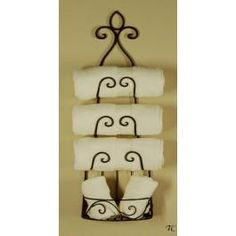 want for my bathroom... put TP where those hand towels are I think!  Wrought Iron Wine Rack - Towel Holder