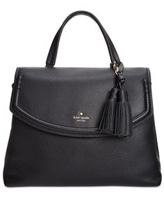 """Trendy tassels add a touch of luxe swing to this structured pebbled leather satchel from kate spade new york. 