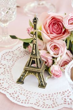 Crystal glasses,a dozen Pink Roses & brass statuette of the Eiffel Tower Quintessential Parisian decor..