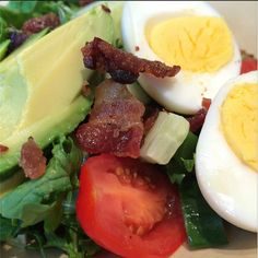 """BLT Salad from my favorite eatery in Denver """"Snooze"""". To recreate at home: Bed of arugula and mixed greens, 1/3 avocado, 3-4 cherry tomatoes sliced in half, cucumber chunks, crumbled nitrate-free bacon, hard-boiled eggs, dressing: Greek yogurt, finely chopped parsley, salt and pepper + seasonings of your choice!"""