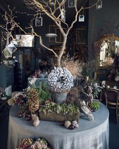 One of my very favourite florists shops... @zita_elze in Kew London. I was there last Friday capturing lots of stunning festive designs. And Ill be featuring my photos shortly on the Flowerona blog. I absolutely adore Zitas exquisite intricate and oh so detailed floristry style...! | #underthefloralspell #londonflorist