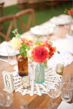 """reminds me of a sweet little wedding we """"went"""" to about a year ago. we adore vintage bottles and wildflowers."""