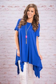 Flowing Free Top, Cobalt || This loose and flowing top is so freeing! You'll feel like you can do or go anywhere! That's mainly because you can! This jagged hemline, generously cut top is perfect for spring all the way through summer! It looks fab with light colored skinnies and long trendy necklace! Plus, the material is so soft and stretchy! It's actually made almost solely of bamboo!
