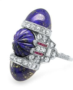 Art Deco Lapis, Ruby & Diamond Bullet Ring  This fantastic carved lapis, callibre ruby and diamond ring evokes the true spirit of the Art Deco period.