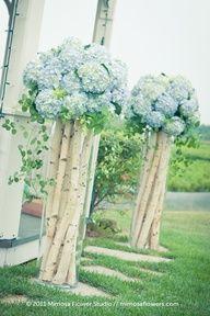 tall arrangements but different flowers