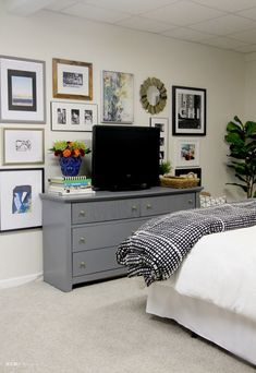 Basement Guestroom Reveal - Basement Bedroom Makeover with painted dresser and TV Gallery Wall - $100 Room Challenge - This is our Bliss