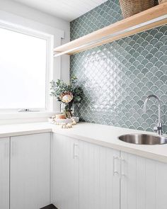 46 Elegant Small White Kitchen Design Ideas for Modern Home These trendy Home Decor ideas would gain you amazing compliments. Check out our gallery for more ideas these are trendy this year. Laundry In Bathroom, House, Interior, Home, Bathroom Interior, Home Kitchens, Fish Scale Tile, Kitchen Design, House And Home Magazine