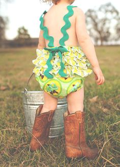 Turquoise floral vintage-inspired sun suit romper, with stripe ruffles and green ric-rac straps, for your tiny country girl