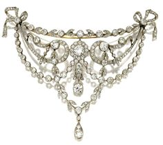 DIAMOND CORSAGE BROOCH, CIRCA 1910    Old European-cut, old mine and rose-cut diamonds weighing approximately 15.75 carats, mounted in gold and platinum.  With fitted box signed D& J. Wellby LTD., Garrick St. London.