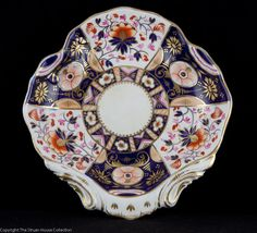 Dating from c1800 this quatrefoil shell dish has unusual puce and peach designs with the more frequently seen cobalt terracotta and red colours of the classic imari design