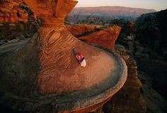 A Bedouin man on top of one of the ancient buildings of Petra, Jordan. Photo by Annie Griffiths