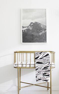 Modern Scandinavian nursery, with a lovely vintage brass colored bassinet