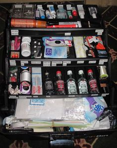 Wedding Emergency Kit in a tackle box. They list everything in it on the site.