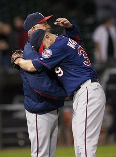 Minnesota Twins pitcher P.J. Walters hugs pitching coach Rick Anderson after Walters threw a complete game in the Twins' 9-2 win over the Chicago White Sox in a baseball game in Chicago on Tuesday, May 22, 2012
