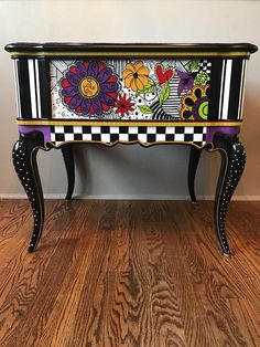 This end table is the only one of its kind!My daughter drew most of the flowery designs on it and I hand painted the table. This table has a glossy polyeurethane finish and will brighten and bring whimsy to your life.