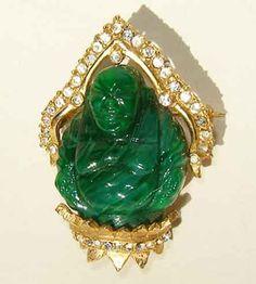 Vintage Hattie Carnegie Buddha brooch with rhinestones.