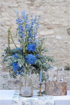 Blue and green wedding flowers | Image by Les Productions de la Fabrik  see full wedding http://goo.gl/vAAdQX