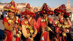 Todos in Morocco: Traditionally-dressed water sellers pose in Marrakech's Djemaa el-Fna square