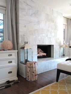 6th Street Design School | Kirsten Krason Interiors : Feature Friday: Moth Design:  The rug, the wood in the acrylic container, fireplace with silver lanterns, fireplace, I love it I love it I love it.