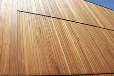 Woodform Architectural's Expression cladding in blackbutt is proving to be a winner for architect Bates Smart who are using it on the Dandenong Ment Shiplap Cladding, Exterior Cladding, Cladding Materials, Cubby Houses, Cubbies, Hardwood Floors, Garage Doors, Spring Valley, House Design
